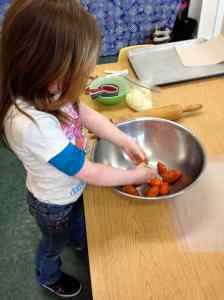 Hadley squeezing tomatoes