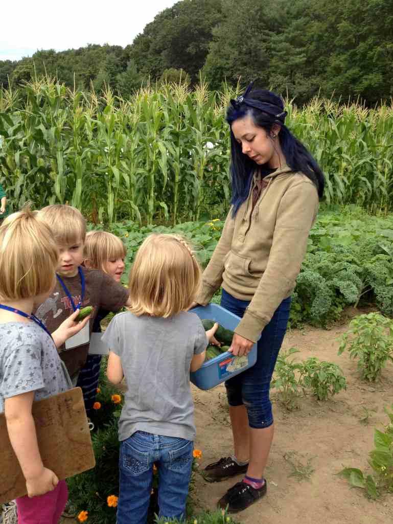 Sharing Cucumbers Teens and Preschoolers