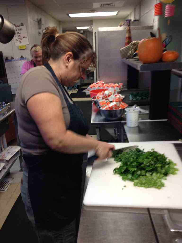 Our kitchen chef, Kim Kinney, using frosted celery in soups.