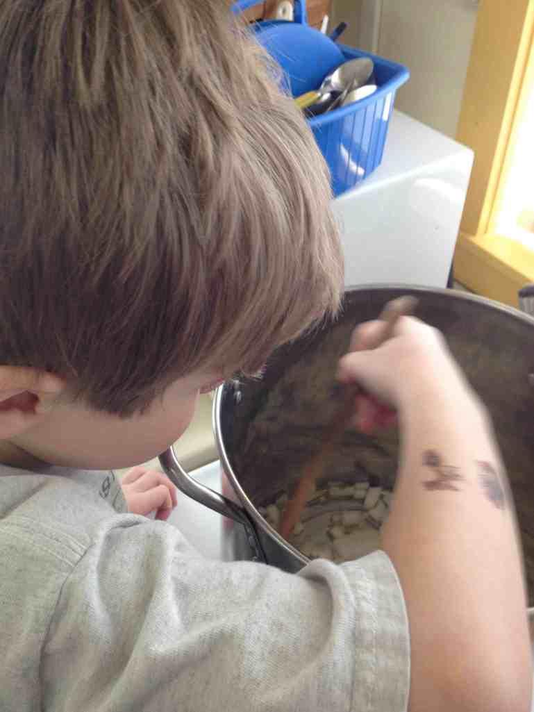 Stirring spinach potato soup