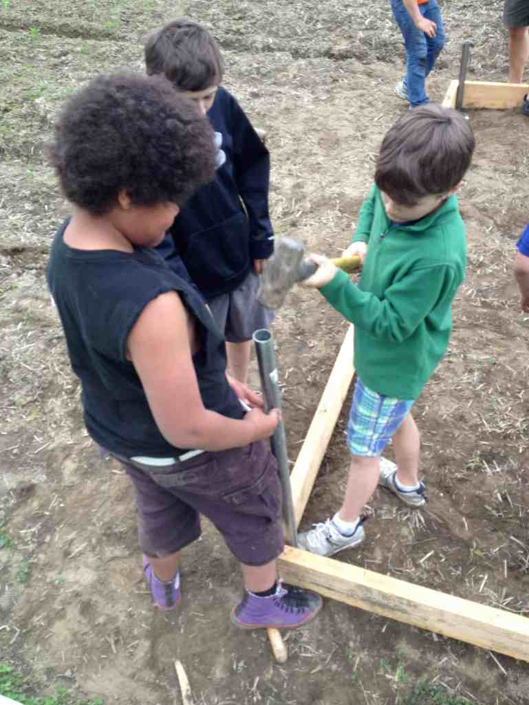 Hammering in posts: Hoop House