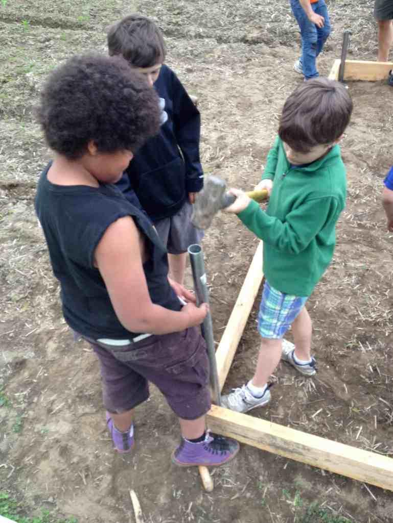 Hammering in posts: Hoop House